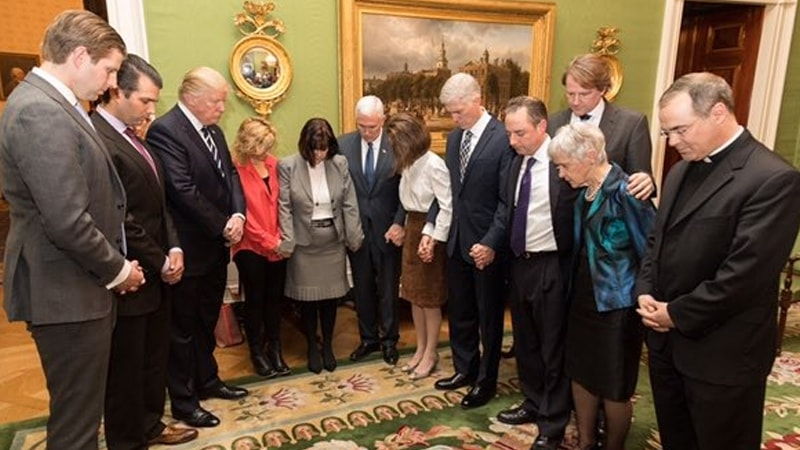 "Trump and staff hypocritically ""praying"""